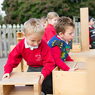 Children building with wooden blocks